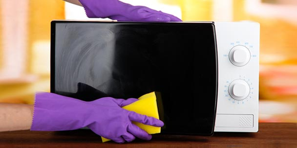 Person Cleaning microwave oven