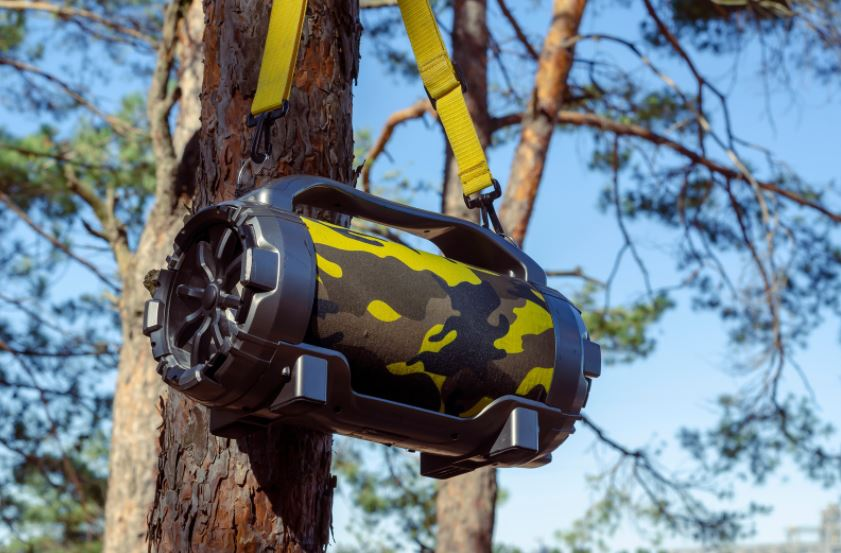 Bluetooth speaker hanging from tree